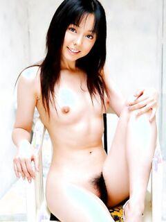 Молодая азиатка ласкает сиськи и волосатую пизду